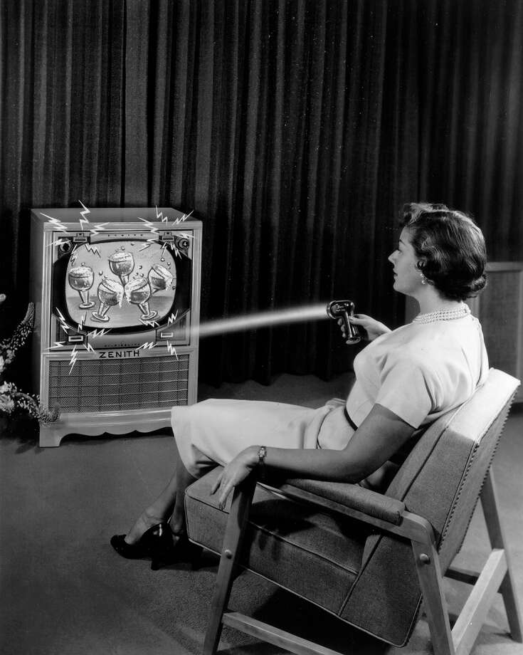 "This 1955 photo illustration provided by LG Electronics, shows an ad for a Zenith ""Flash-Matic,"" the first wireless TV remote control. A spokesman for Zenith Electronics says engineer Eugene Polley, the inventor of the device, died May 20, 2012, of natural causes in Downers Grove, Ill. He was 96. Polley and fellow Zenith engineer Robert Adler were honored in 1997 with Emmys for their work in pioneering TV remotes. Photo: AP"