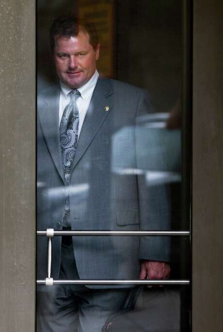 Former Major League Baseball pitcher Roger Clemens leaves federal court in Washington, Monday, May 21, 2012, after a day of testimony in the sixth week of the perjury trial that will determine whether Clemens lied to Congress in 2008 when the 11-time All-Star pitcher denied using performance-enhancing drugs. Photo: AP