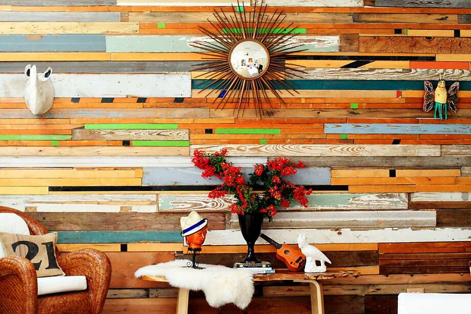 This undated image released by R & R Designworks shows how Sarah Reiss sources reclaimed wood to make custom wall art. She's used gymnasium flooring, bowling alleys, barn wood and shiplap to craft her wall art and smaller scaled tables. (AP Photo/R & R Designworks) Photo: Associated Press