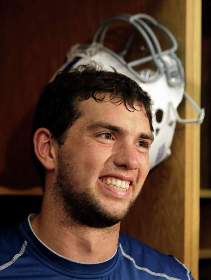 Indianapolis Colts quarterback Andrew Luck is interviewed at his locker following the first practice of the NFL team's football rookie mini-camp in Indianapolis, Friday, May 4, 2012. Photo: AP