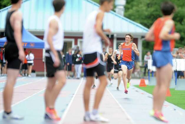 Danbury's Mickey Kozak competes in the 4x800 meter relay during the FCIAC boys and girls track championships held Tuesday, May 22, 2012 at Danbury High School. Photo: Autumn Driscoll / Connecticut Post