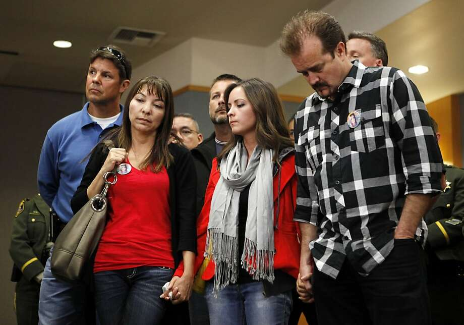 Sierra LaMar's mother, Marlene LaMar (L), sister Danielle (C) and father Steve (R) stand together during a news conference regarding the arrest of Antolin Garcia-Torres at the Santa Clara County Sheriff's Office on Tuesday May 22, 2012 in San Jose, Calif. Photo: Beck Diefenbach, Special To The Chronicle