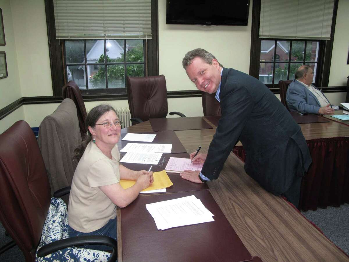 Selectman Beth Jones with new Democratic candidate for the 125th District, Mark Robbins, as he signs the party's official endorsement papers Tuesday night at New Canaan Town Hall. May 21, 2012. New Canaan, CT