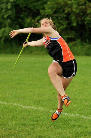 Ridgefield's Ellie Gravitte competes in the javelin during the FCIAC track and field championships at Danbury High School on Tuesday, May 22, 2012. Gravitte received first place in the javelin. Photo: Jason Rearick / The News-Times