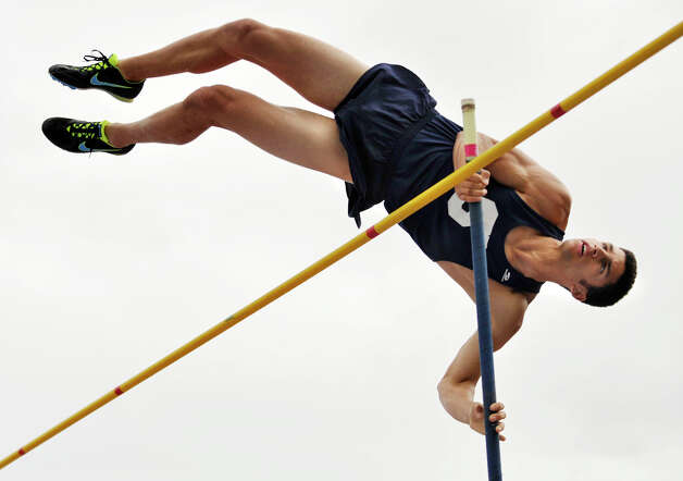 Staples' Dean Hefnawy competes in the high jump during the FCIAC track and field championships at Danbury High School on Tuesday, May 22, 2012. Hefnawy tied for first place. Photo: Jason Rearick / The News-Times