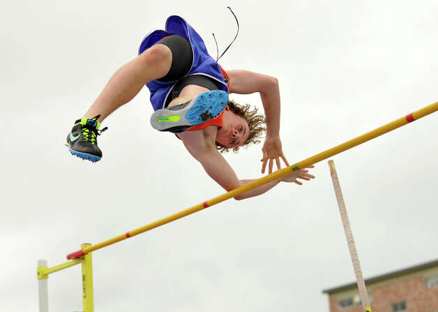 Danbury's Christian Partenio competes in the high jump during the FCIAC track and field championships at Danbury High School on Tuesday, May 22, 2012. Photo: Jason Rearick / The News-Times