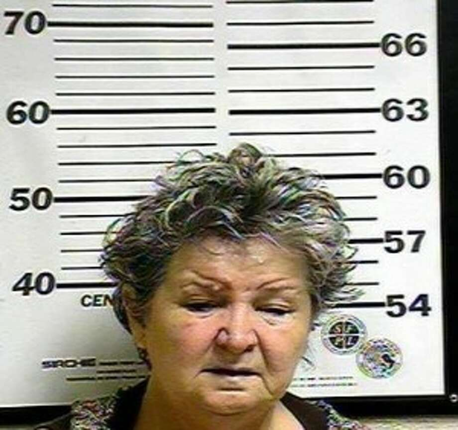 Handout of booking photo of Evie Mearlene Herrin, 57, who along with her daughter Amelia Darci Crew, 30, is accused of holdups Feb. 13 in Kinder, and of other bank robberies in Sulphur, La., and Henderson, Texas, Photo: Handout / handout