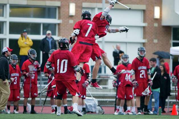 New Canaan celebrates a goal as New Canaan and Wilton face off in the FCIAC boys lacrosse semifinals at Brien McMahon High School in Norwalk, Conn., May 22, 2012. New Canaan won the game, 11-6. Photo: Keelin Daly / Stamford Advocate