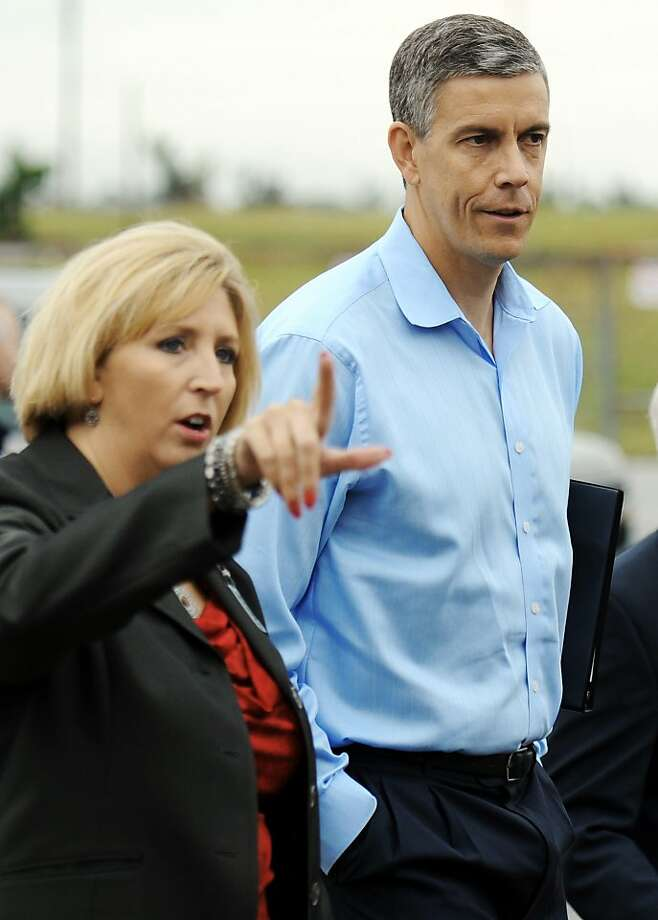 Secretary of Education Arne Duncan overlooks the May 22 tornado damage to Joplin High School as Joplin R8 Assistant Superintendent Angie Besendorfur points out damage,Thursday morning, Sept. 22, 2011 in Joplin, Mo. (AP photo/The Joplin Globe, T. Rob Brown) Photo: T. Rob Brown, Associated Press