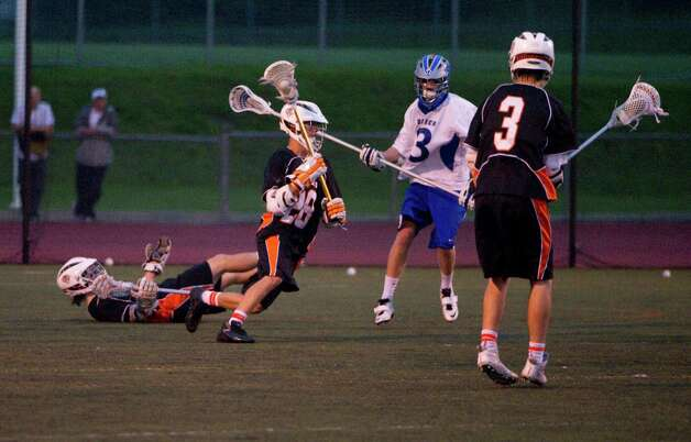 Ridgefield's Timothy Kelly scored four goals in the first half as Darien and Ridgefield face off in the FCIAC boys lacrosse semifinals at Brien McMahon High School in Norwalk, Conn., May 22, 2012. Photo: Keelin Daly / Stamford Advocate