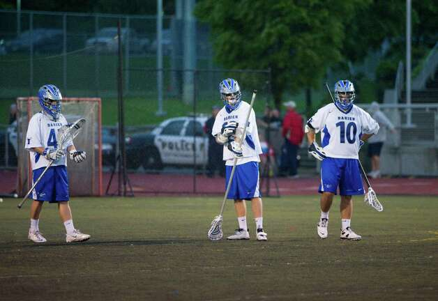 Frustration as Darien and Ridgefield face off in the FCIAC boys lacrosse semifinals at Brien McMahon High School in Norwalk, Conn., May 22, 2012. Photo: Keelin Daly / Stamford Advocate