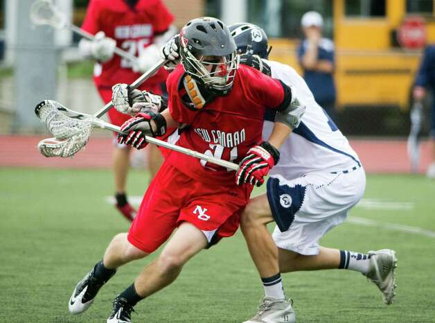 New Canaan's Jack Bratches and Wilton's William Kelley battle as New Canaan and Wilton face off in the FCIAC boys lacrosse semifinals at Brien McMahon High School in Norwalk, Conn., May 22, 2012. New Canaan won the game, 11-6. Photo: Keelin Daly / Stamford Advocate