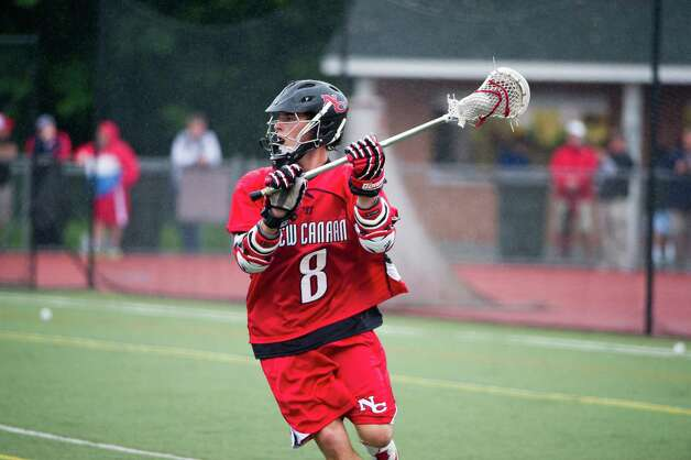 New Canaan and Wilton face off in the FCIAC boys lacrosse semifinals at Brien McMahon High School in Norwalk, Conn., May 22, 2012. New Canaan won the game, 11-6. Photo: Keelin Daly / Stamford Advocate