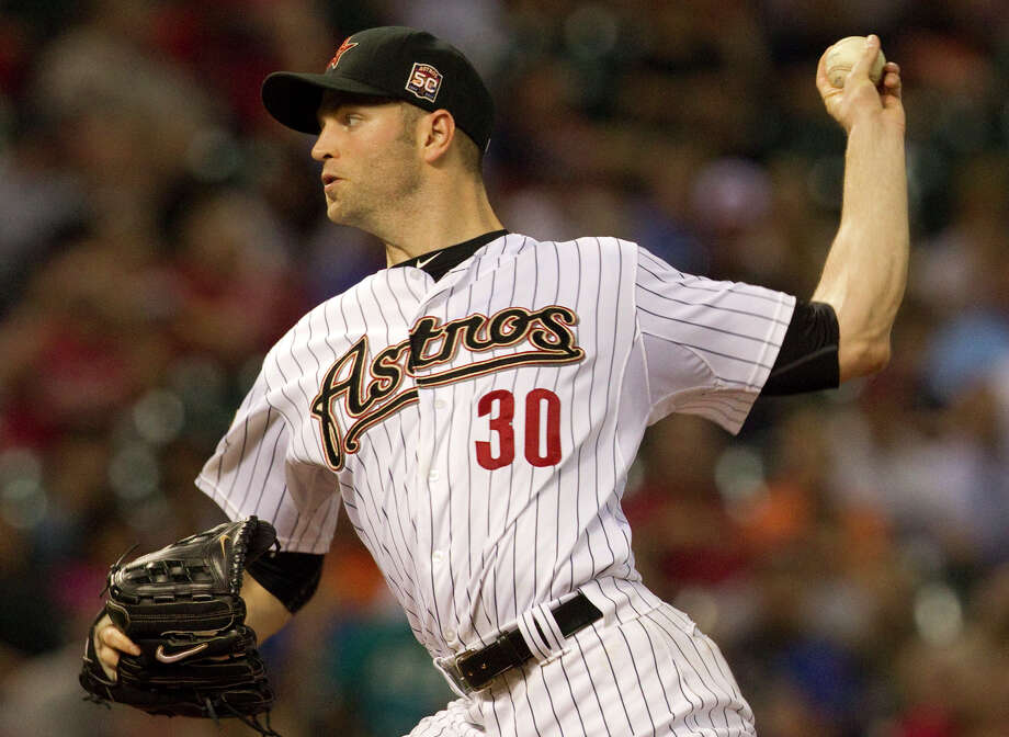 Houston Astros starting pitcher J.A. Happ delivers a pitch to the Chicago Cubs during a baseball game at Minute Maid Park Tuesday, May 22, 2012, in Houston. Photo: Cody Duty, Houston Chronicle / © 2011 Houston Chronicle