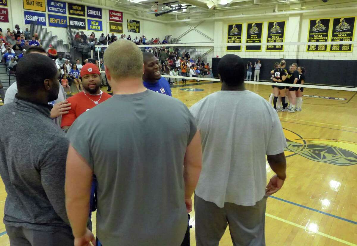 New York Giants veterans and rookies review their game plan before playing the College of Saint Rose women's volleyball team in an exhibition volleyball game at the college in Albany N.Y. Tuesday May 22, 2012. (Michael P. Farrell/Times Union)