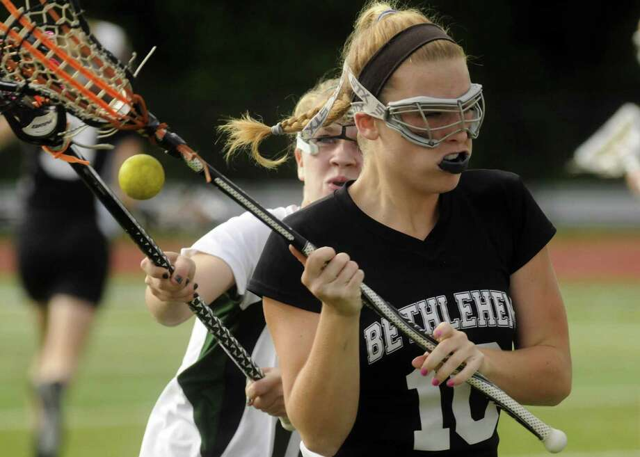 Bethlehem's Abbey Seymour, right, gets the ball knocked from her control by Shenendehowa's Paige Byrne during their girls lacrosse Class A semifinal in Clifton Park N.Y. Tuesday May 22, 2012. (Michael P. Farrell/Times Union) Photo: Michael P. Farrell