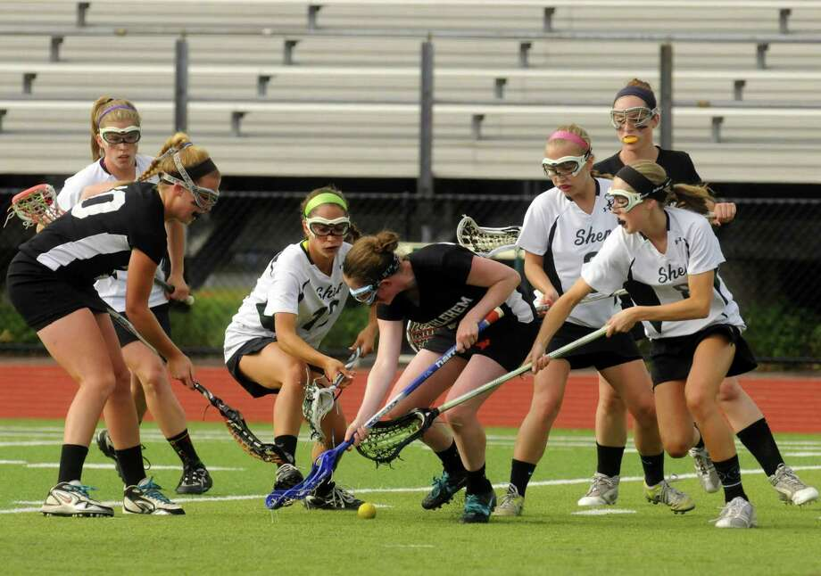 Bethlehem and Shenendehowa players battle for the ball during their girls lacrosse Class A semifinal in Clifton Park N.Y. Tuesday May 22, 2012. (Michael P. Farrell/Times Union) Photo: Michael P. Farrell