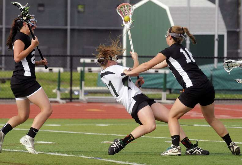 Shenendehowa's Kelly Wall is stopped by Bethlehem's Gianna Calabrese during their girls lacrosse Cla