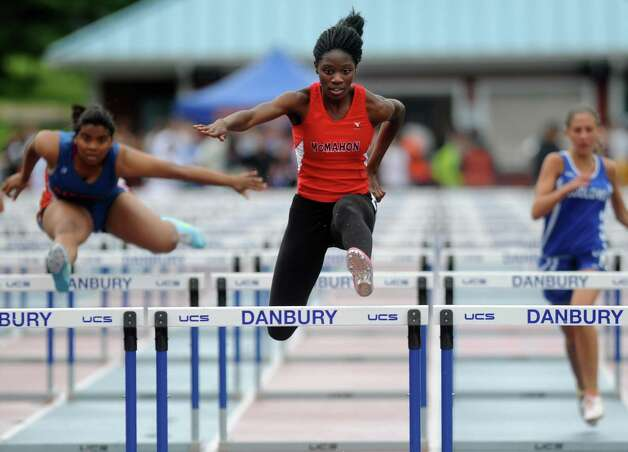 Brien McMahon's Shelly Lindo competes in the 100 meter hurdles during the FCIAC boys and girls track championships held Tuesday, May 22, 2012 at Danbury High School. Photo: Autumn Driscoll / Connecticut Post