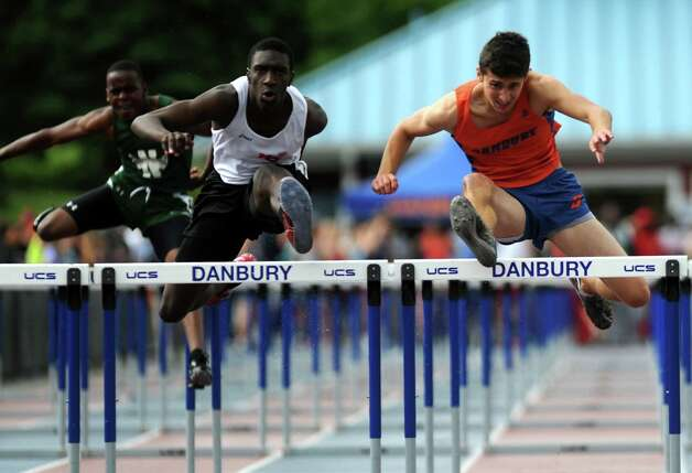 Danbury's Shane Chiaravalle, far right, competes in the 110 meter high hurdles during the FCIAC boys and girls track championships held Tuesday, May 22, 2012 at Danbury High School. Photo: Autumn Driscoll / Connecticut Post