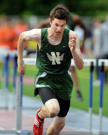 Norwalk's Adam Robertino competes in the 110 meter high hurdles during the FCIAC boys and girls track championships held Tuesday, May 22, 2012 at Danbury High School. Photo: Autumn Driscoll / Connecticut Post