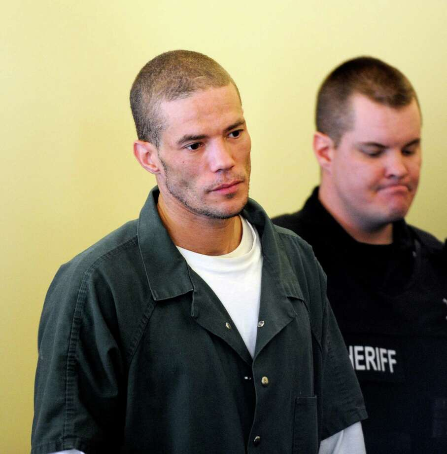 Michael Moon, left, during his arraignment at Rensselaer County Court in Troy, N.Y., Feb. 10, 2012. Moon gave details Tuesday on how he used a gun to rob several stores last year and how one clerk fought him until they were both bloodied. (Skip Dickstein / Times Union archive) Photo: SKIP DICKSTEIN / 2011