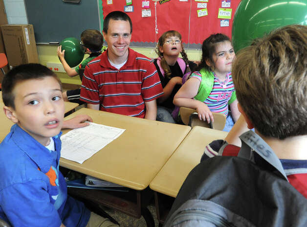"Karigon Elementary School teacher Bryan Sawyer with some of his students Tuesday, May 22, 2012 in Clifton Park, N.Y. The students are clockwise from bottom left Jacob Miller, Charlie Wilkinson, Lucy Hess, Maria Fessia and Miles Rosenberry. Sawyer was named ""top teacher"" on the ""Live with Kelly"" show. He gets a car, computers for his classroom and a $25,000 donation to the school. (Lori Van Buren / Times Union) Photo: Lori Van Buren"