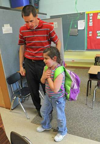 "Karigon Elementary School teacher Bryan Sawyer walks student Maria Fessia to the door at the end of the school day Tuesday, May 22, 2012 in Clifton Park, N.Y. Sawyer was named ""top teacher"" on the ""Live with Kelly"" show. He gets a car, computers for his classroom and a $25,000 donation to the school. (Lori Van Buren / Times Union) Photo: Lori Van Buren"
