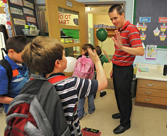 "Karigon Elementary School teacher Bryan Sawyer waves as he says goodbye to his students at the end of the school day Tuesday, May 22, 2012 in Clifton Park, N.Y.  Miles Rosenberry waves back. Sawyer was named ""top teacher"" on the ""Live with Kelly"" show. He gets a car, computers for his classroom and a $25,000 donation to the school. (Lori Van Buren / Times Union) Photo: Lori Van Buren"