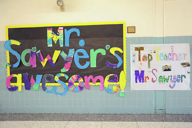 "Signs made by students for teacher Bryan Sawyer were ubiquitous at Karigon Elementary School Tuesday, May 22, 2012 in Clifton Park, N.Y. Sawyer was named ""top teacher"" on the ""Live with Kelly"" show. He gets a car, computers for his classroom and a $25,000 donation to the school. (Lori Van Buren / Times Union) Photo: Lori Van Buren"