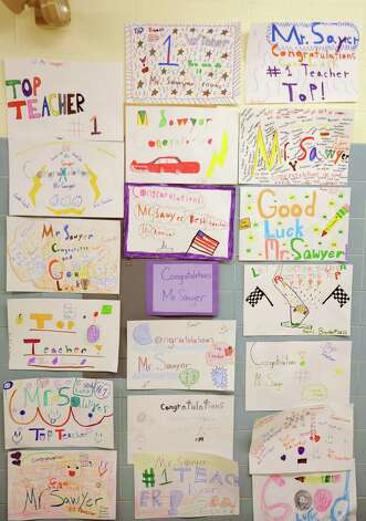 "Signs and artwork made by students for teacher Bryan Sawyer were ubiquitous at Karigon Elementary School Tuesday, May 22, 2012 in Clifton Park, N.Y. Sawyer was named ""top teacher"" on the ""Live with Kelly"" show. He gets a car, computers for his classroom and a $25,000 donation to the school. (Lori Van Buren / Times Union) Photo: Lori Van Buren"