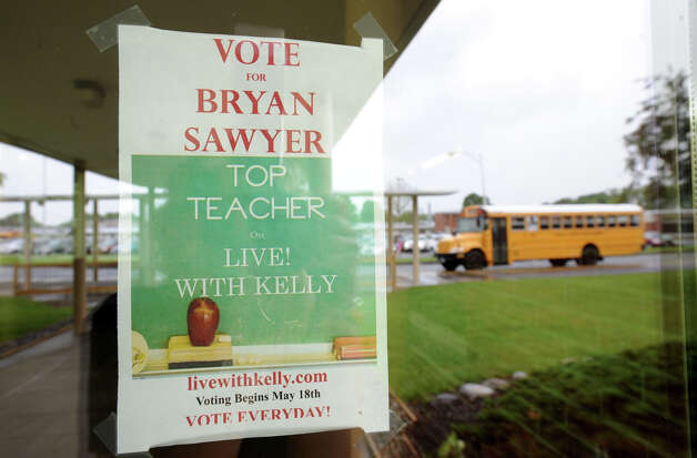 "A sign to vote for teacher Bryan Sawyer at Karigon Elementary School Tuesday, May 22, 2012 in Clifton Park, N.Y. Sawyer was named ""top teacher"" on the ""Live with Kelly"" show. He gets a car, computers for his classroom and a $25,000 donation to the school. (Lori Van Buren / Times Union) Photo: Lori Van Buren"