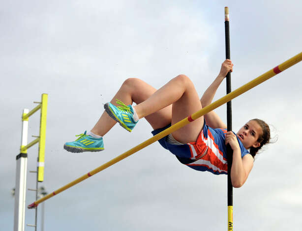 Danbury's Emma Lutz competes in the pole vault during the FCIAC track and field championships at Danbury High School on Tuesday, May 22, 2012. Photo: Jason Rearick / The News-Times