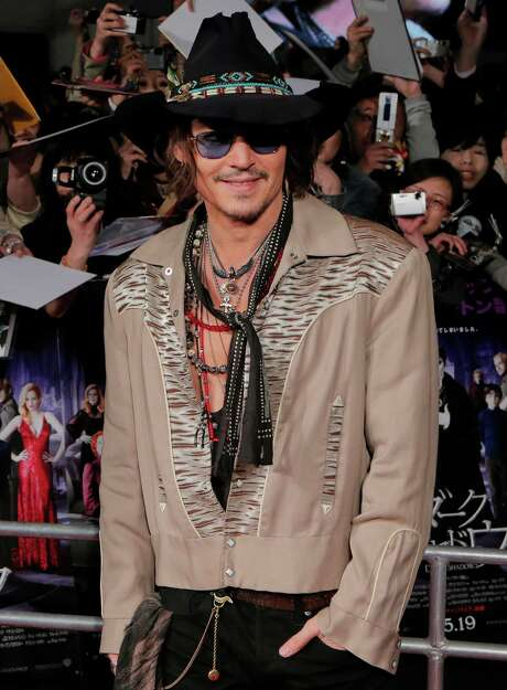 "Actor Johnny Depp poses at the premiere of ""Dark Shadows"" in Tokyo, Saturday, May 12, 2012. Dark Shadows will be released in Japan, May 19. (AP Photo/Itsuo Inouye) Photo: Itsuo Inouye / AP"