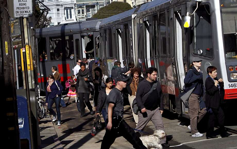 Passengers get off the N Judah line at Cole St. and Carl St. in San Francisco, Calif., Tuesday, May 22, 2012.  The line is shutting down for nine days starting Friday. Photo: Sarah Rice, Special To The Chronicle