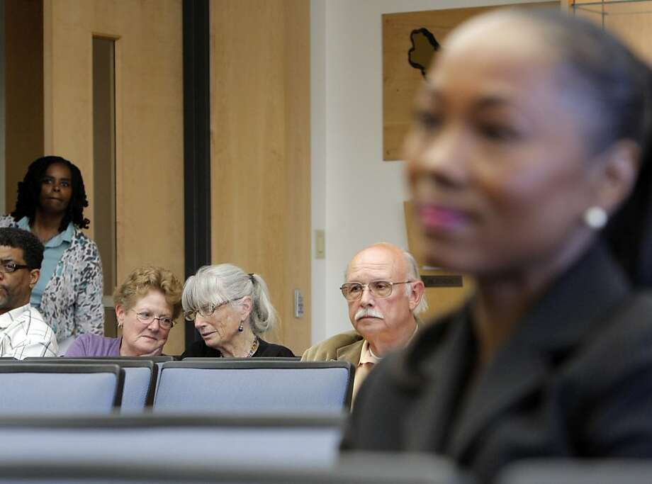 Gail Steele, background center right, talks to Paula Barber after her presentation at the Alameda County Board of Supervisors. She she is one of the five finalists to replace Nadia Lockyer in Oakland, Calif. on May 22, 2012. Photo: Siana Hristova, The Chronicle