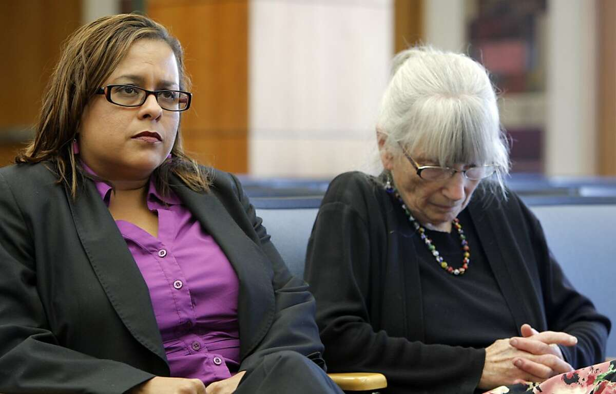 Ana Apodaca,left, and Gail Steele, wait their turn to address the Alameda County Board of Supervisors for the selection of five finalists to be interviewed next week to replace Nadia Lockyer in Oakland, Calif. on May 22, 2012.