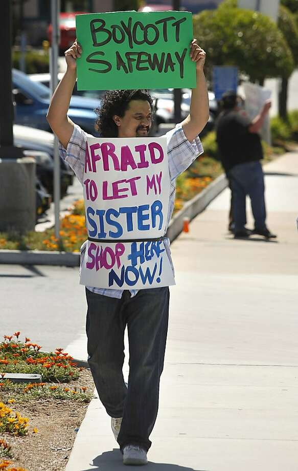 Christopher Minglana holds a sign in support of Ryan Young, a butcher at a Monterey County Safeway, outside the store in Del Rey Oaks, Calif. on Sunday May 20, 2012. Young was suspended without pay after he stopped a customer from hitting his pregnant girlfriend in the store last month.  (AP Photo/ Monterey County Herald, David Royal) Photo: David Royal, Associated Press