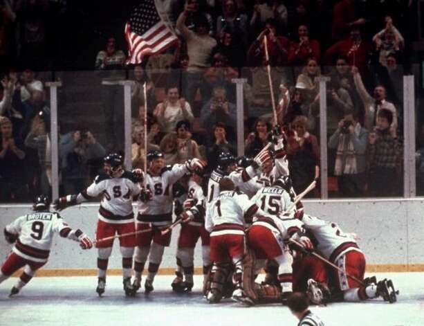 "17. The U.S. Olympic hockey team pounces on goalie Jim Craig after a 4-3 victory against the Soviet Union in the 1980 Olympics in Lake Placid. The shocking upset was dubbed ""The Miracle on Ice.""  (Associated Press)"