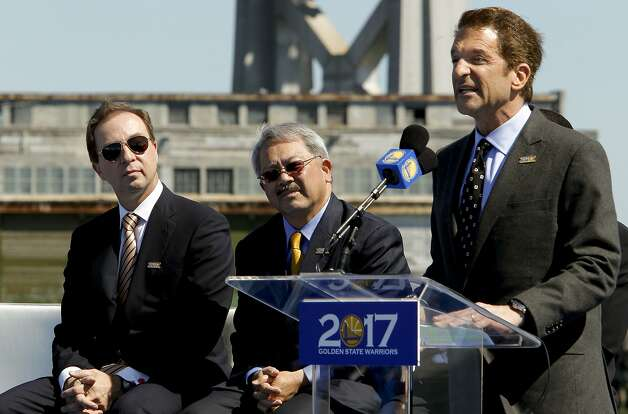 Golden State Warriors basketball team executives, Peter Guber, (right) and Joe Lacob  join San Francisco Mayor Ed Lee, (center) as they officially announced plans, on Tuesday May 22, 2012, in San Francisco,Ca., to build a new arena on Piers 30 and 32 in time for the start of the 2017-2018 NBA season. Photo: Michael Macor, The Chronicle