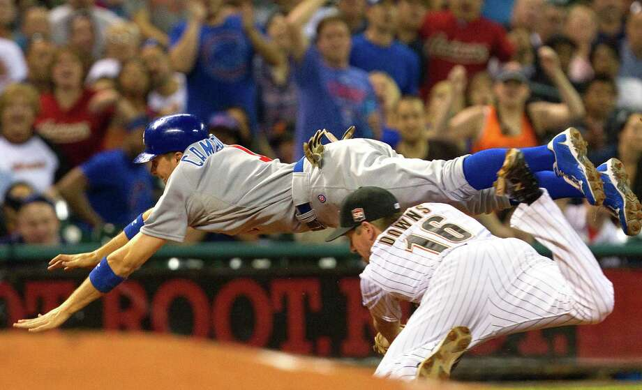 The Cubs' Tony Campana gives an all-out effort as he avoids a tag by Astros third baseman Matt Downs in the eighth inning. Campana went from first to third on a two-base throwing error but was stranded. Photo: Cody Duty / © 2011 Houston Chronicle