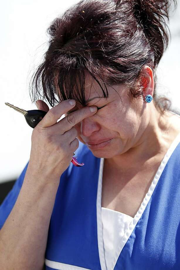 "Laura Torres, mother of the suspect, says her son told her, ""I have never seen that lady."" Photo: Beck Diefenbach, Special To The Chronicle"