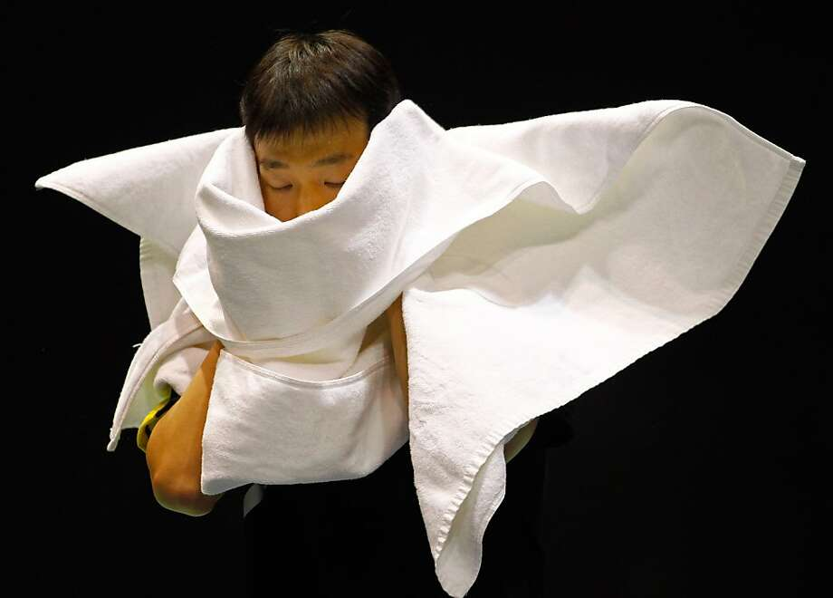 TOPSHOTS Lee Il Hyun of South Korea wipes his face during the Group D match against Marc Zwiebler of Germany at the Thomas Cup world badminton team championships in China's central city of Wuhan, in Hubei province on May 22, 2012. South Korea defeated Germany 3-2. AFP PHOTOSTR/AFP/GettyImages Photo: Str, AFP/Getty Images
