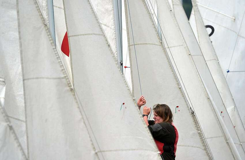 At Lakewood Boating Center, Western Washington University junior Sigrid Williams hauls up a sail during a WWU sailing class on Lake Whatcom on Tuesday, May 22, 2012 in Bellingham, Wash. (AP Photo/The Bellingham Herald, Andy Bronson)