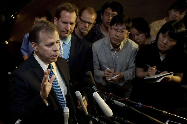 "US special envoy for North Korea policy Glyn Davies (L) gives a press conference at a hotel in Beijing on May 22, 2012. Davies warned North Korea against conducting another nuclear test, saying it would be a ""serious mistake"" that would incur more sanctions and further isolation. AFP PHOTO / Ed JonesEd Jones/AFP/GettyImages Photo: Ed Jones, AFP/Getty Images"
