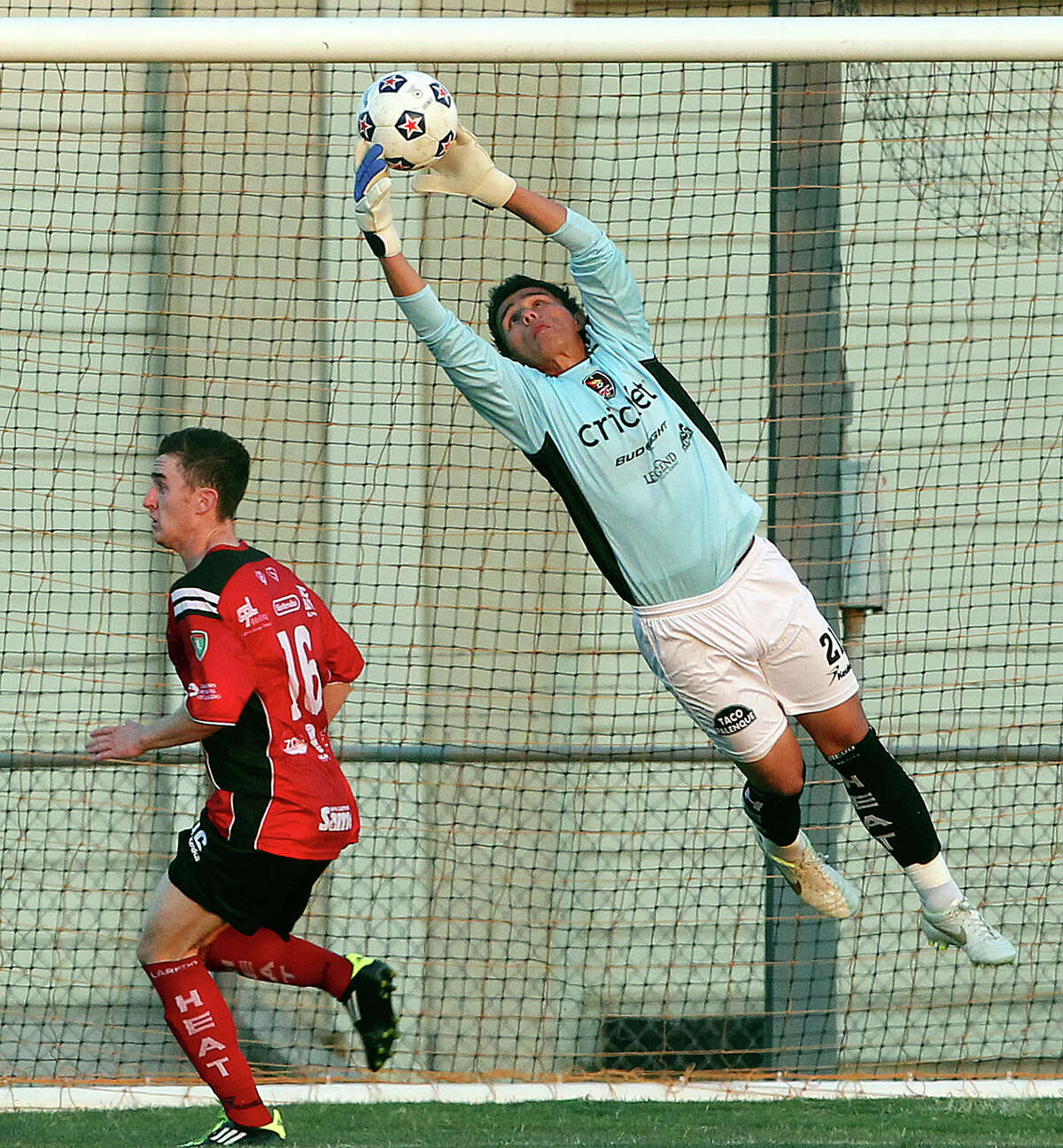 Laredo goalie Ernest Serrato pulls down a shot with teammate Aaron Pitchkolan moving underneath as the San Antonio Scorpions play the Laredo Heat in a U.S. Open Cup game at Blossom Soccer Stadium on May 22, 2012.