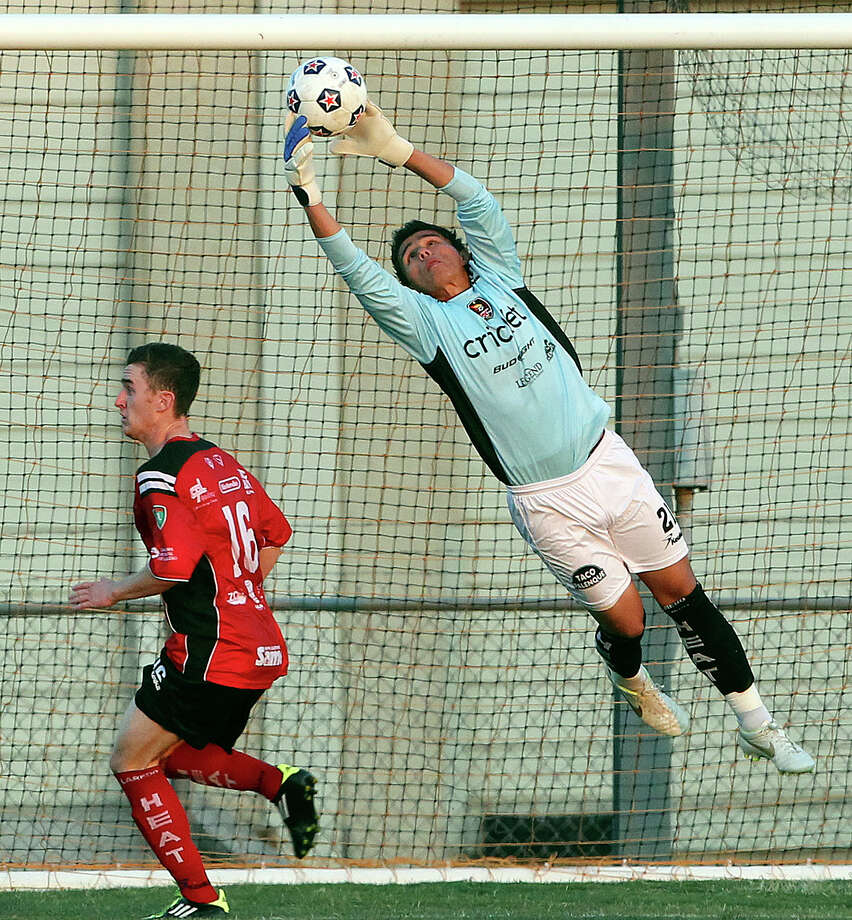 Laredo goalie Ernest Serrato pulls down a shot with teammate Aaron Pitchkolan moving underneath as the San Antonio Scorpions play the Laredo Heat in a U.S. Open Cup game at Blossom Soccer Stadium on May 22, 2012. Photo: Tom Reel, Express-News / ©2012 San Antono Express-News