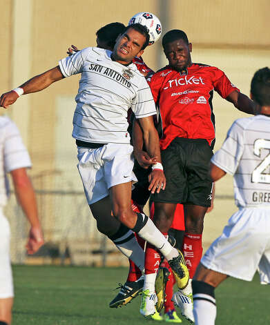San Antonio's Pablo Campos  battles for a header against Greg Mulamba as the San Antonio Scorpions play the Laredo Heat in a U.S. Open Cup game at Blossom Soccer Stadium on May 22, 2012. Photo: Tom Reel, Express-News / ©2012 San Antono Express-News