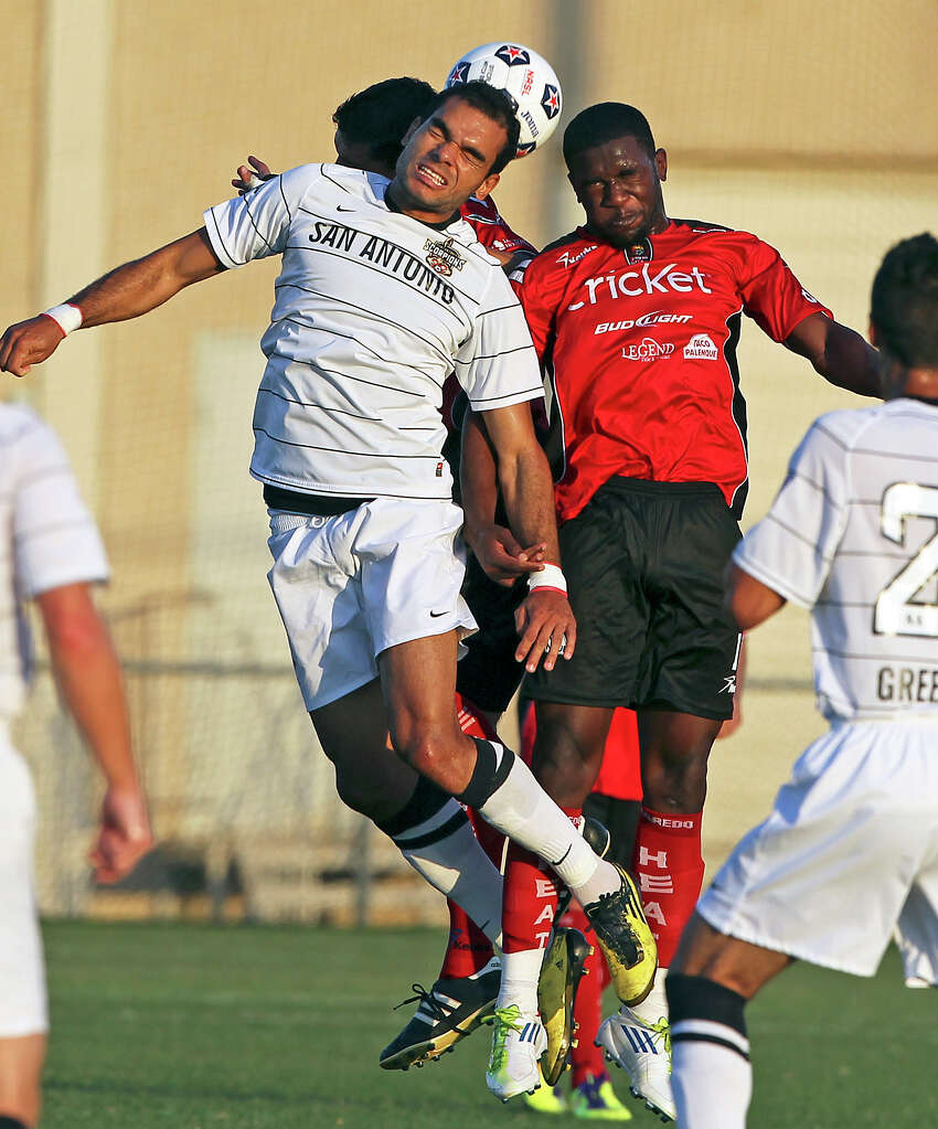 San Antonio's Pablo Campos battles for a header against Greg Mulamba as the San Antonio Scorpions play the Laredo Heat in a U.S. Open Cup game at Blossom Soccer Stadium on May 22, 2012.