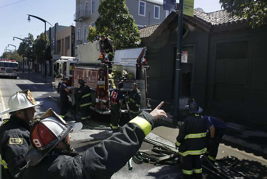 Firefighters work in front of the former Potrero police station, which closed more than 15 years ago, on Tuesday, May 22, 2012 in San Francisco, Calif.  A two alarm fire broke out at the former Potrero police station on the corner of Third and 20th Streets on Tuesday afternoon. Photo: Lea Suzuki, The Chronicle